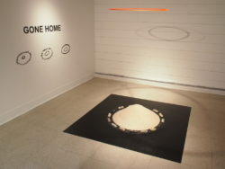 """Gone Home"" sculpture. The wilderness symbol for 'I've gone home' Sand, cast soap, felt, linoleum, plexi"